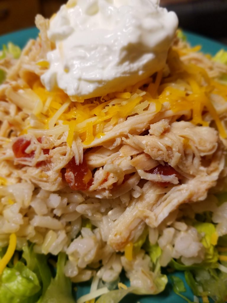 This Slow Cooker Fiesta Chicken is so versatile you can use it in different ways for several lunches and dinners.